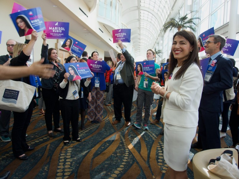 Scene of Marisol Rubio standing with supporters at the California Democratic Party endorsement caucuses in Long Beach