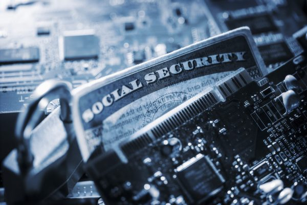 Social Security card, padlock and circuit board. Internet Security concept.