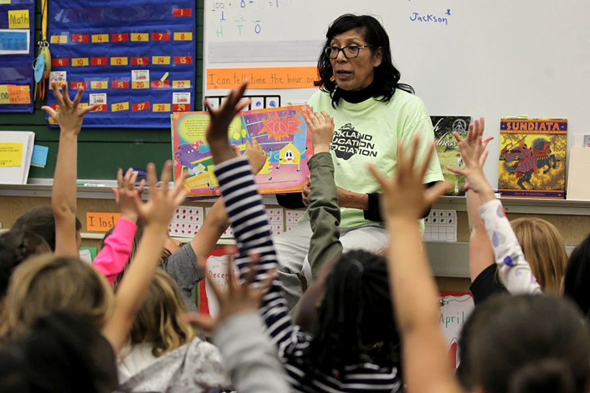 Carol Pancho reads to her first grade class at Sequoia Elementary School in Oakland, Calif., on Wednesday, April 26, 2017. Pancho is retiring at the end of the school year after 37 years of teaching. Photo by Anda Chu, Bay Area News Group