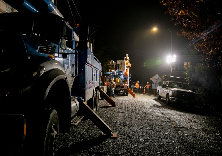 PG&E workers replace an electric pole in Berkeley