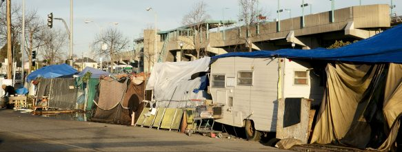 A tent encampment by the West Oakland BART station. Photo by Anne Wernikoff for CalMatters