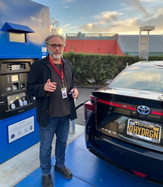 Aaron Slavin fuels his hydrogen-powered car, a 2017 Toyota Mrai