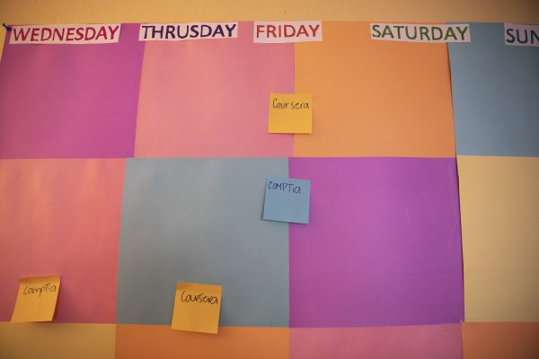 A colorful calendar on Maria's office wall helps her keep track of her course schedule