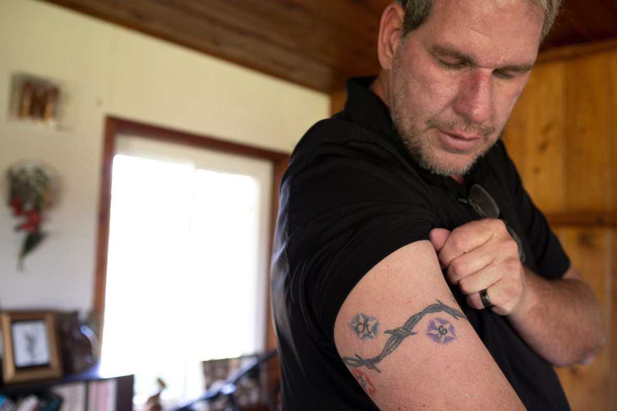 Foster parent Andrew Simmons, of Ramona, CA, has the initials of all six of his adopted children on his arm