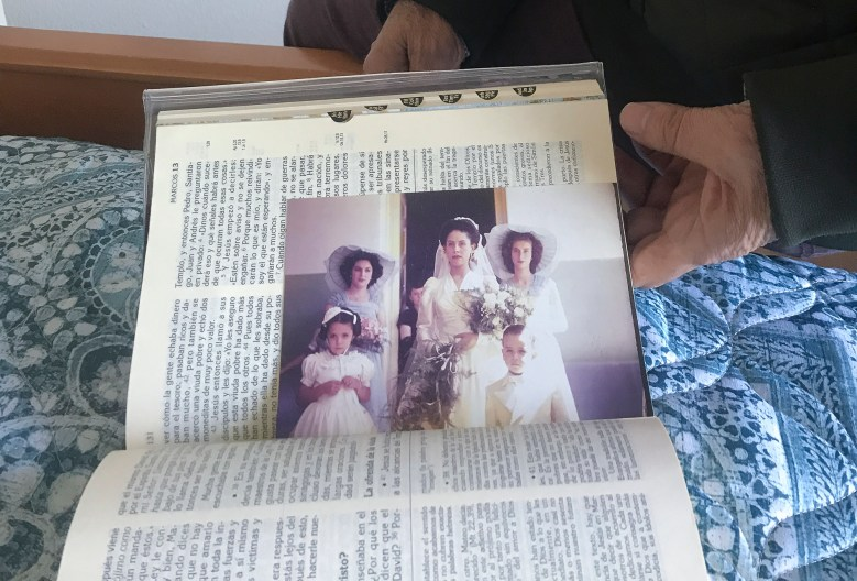 Eduardo Mendoza, 66, keeps a photo of his mother on her wedding day tucked between the pages of his Bible. Photo by Jackie Botts for CalMatters