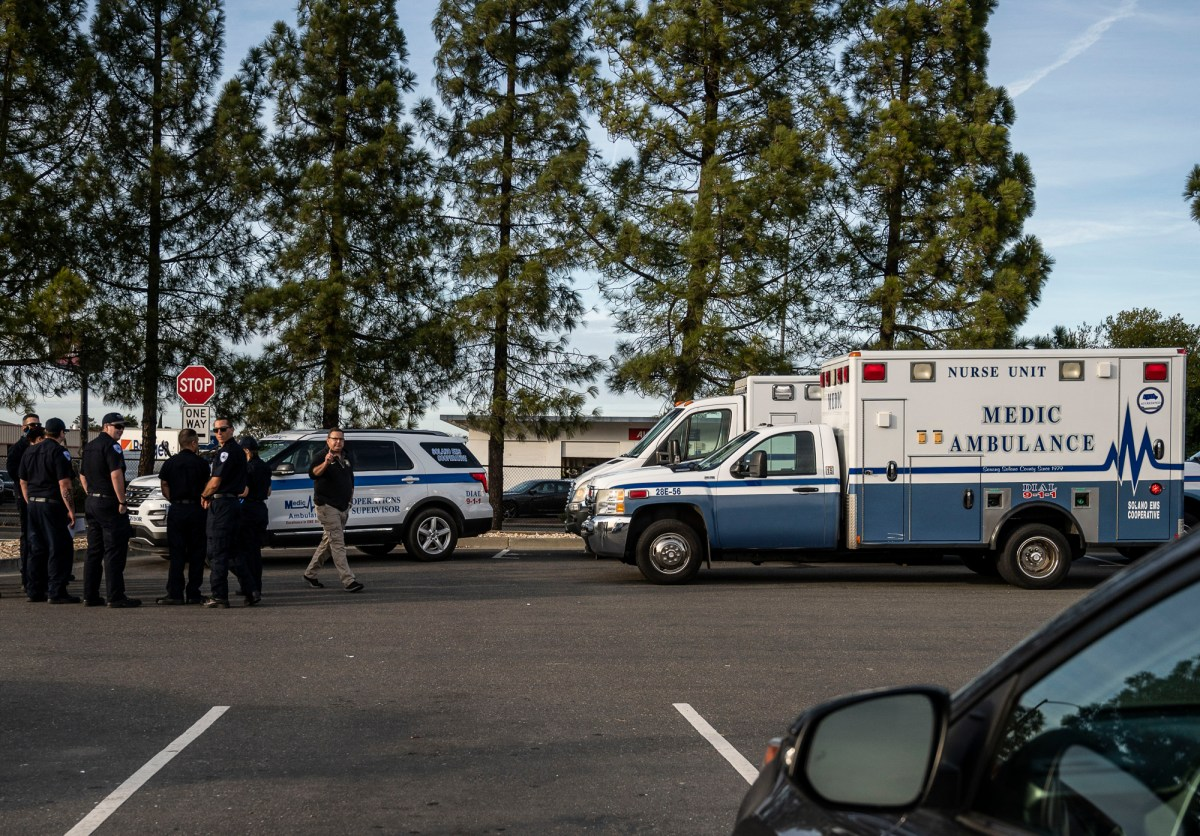Ambulances are outside Travis Air Force Base., where Americans have been evacuated from overseas for quarantine after being exposed to, or sickened by, the coronavirus. Photo by Hector Amezcua, AP Photo.