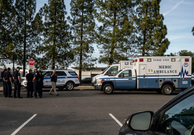 A group of ambulances from the Solano EMS Cooperative stage at the visitor center at Travis Air Force Base, adjacent to Fairfield, Calif., Sunday, Feb. 16, 2020.