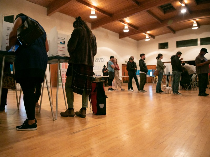People line up to receive their ballots at BeeBee Memorial Christian Methodist church in Oakland on Super Tuesday 2020. Photo by Anne Wernikoff for CalMatters