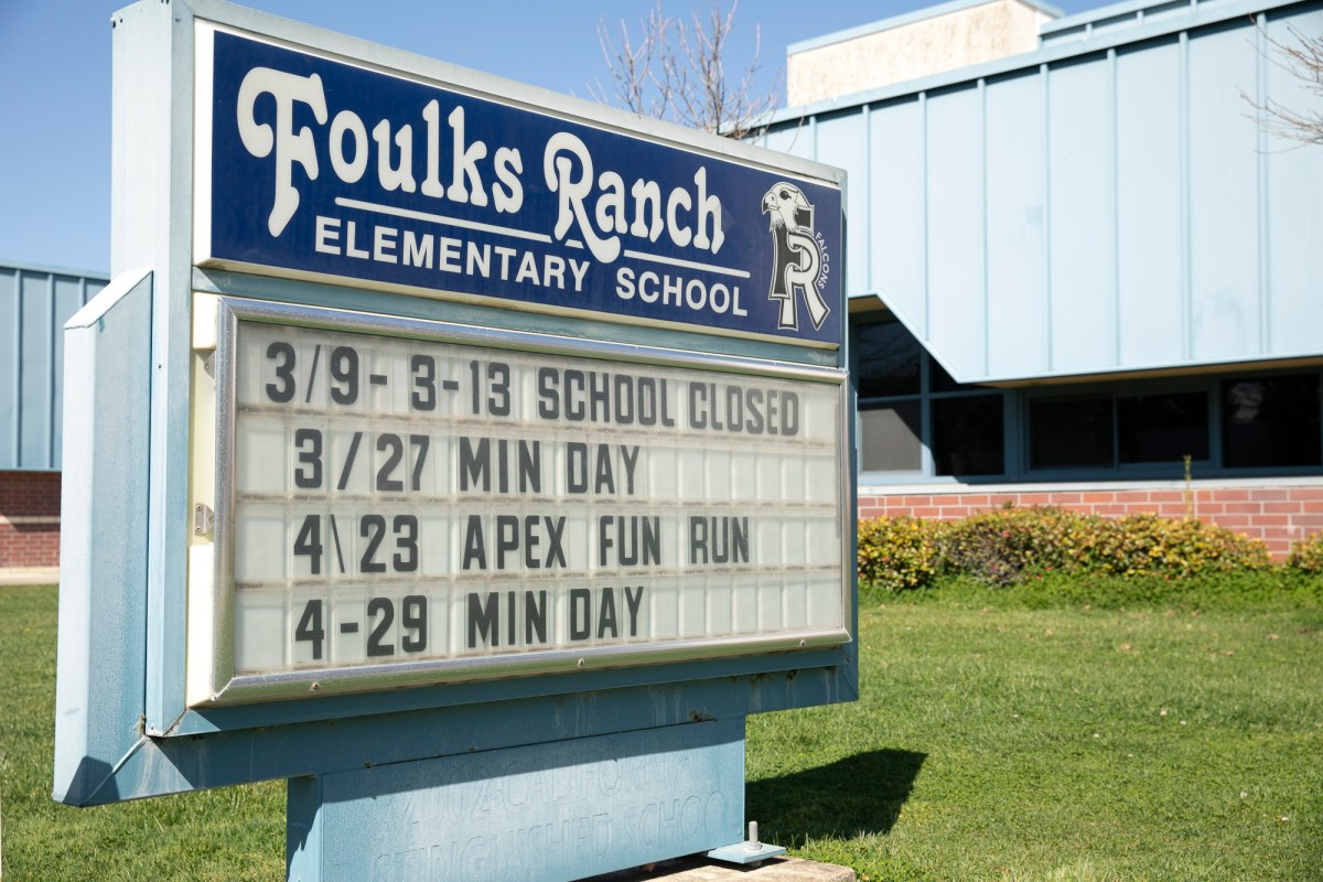 Week-long school closure is announced on the marquee at Foulks Ranch elementary school in Elk Grove. Elk Grove Unified closed all district schools until March 13 after a student tested positive for COVID-19. Photo by Anne Wernikoff for CalMatters