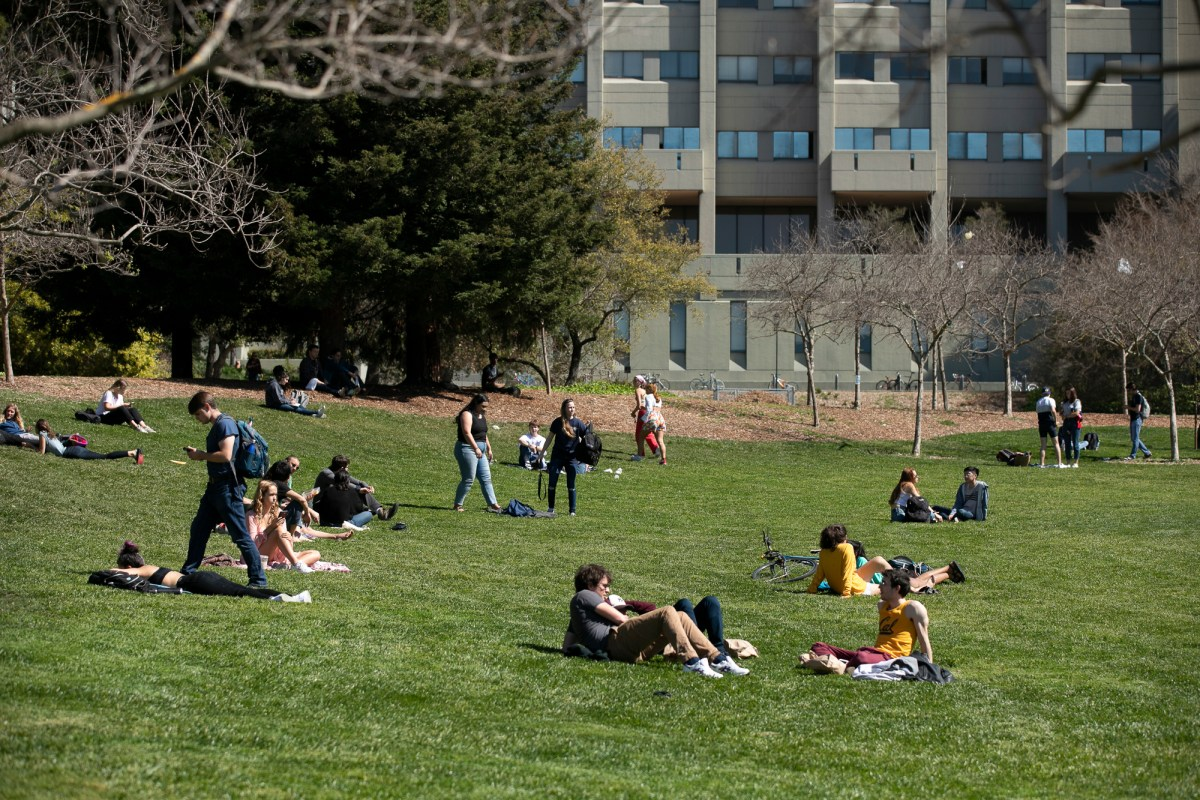 Students sunbathe on the lawn at UC Berkeley on March 12, 2020. The university suspended most in-person classes on Tuesday due to Coronavirus concerns. Photo by Anne Wernikoff for CalMatters