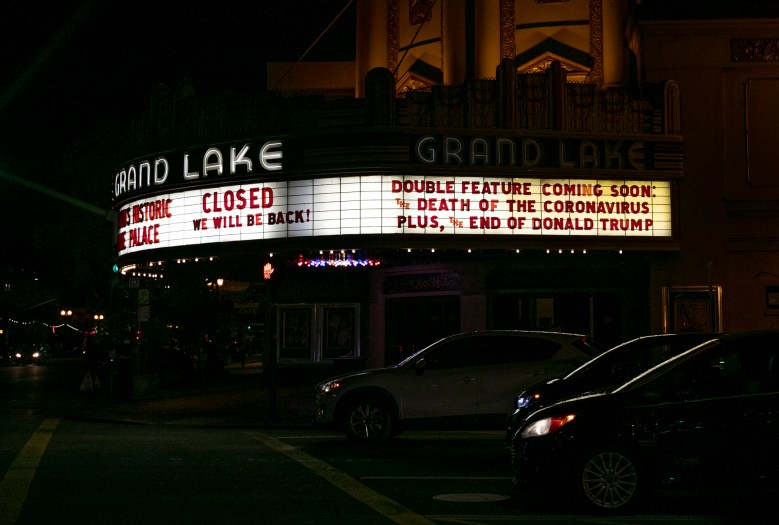 The marquee at Grand Lake Theatre in Oakland announces their temporary closure on March 16, 2020. Today, seven counties enacted a shelter in place order until April 7 to curb the spread of novel coronavirus.