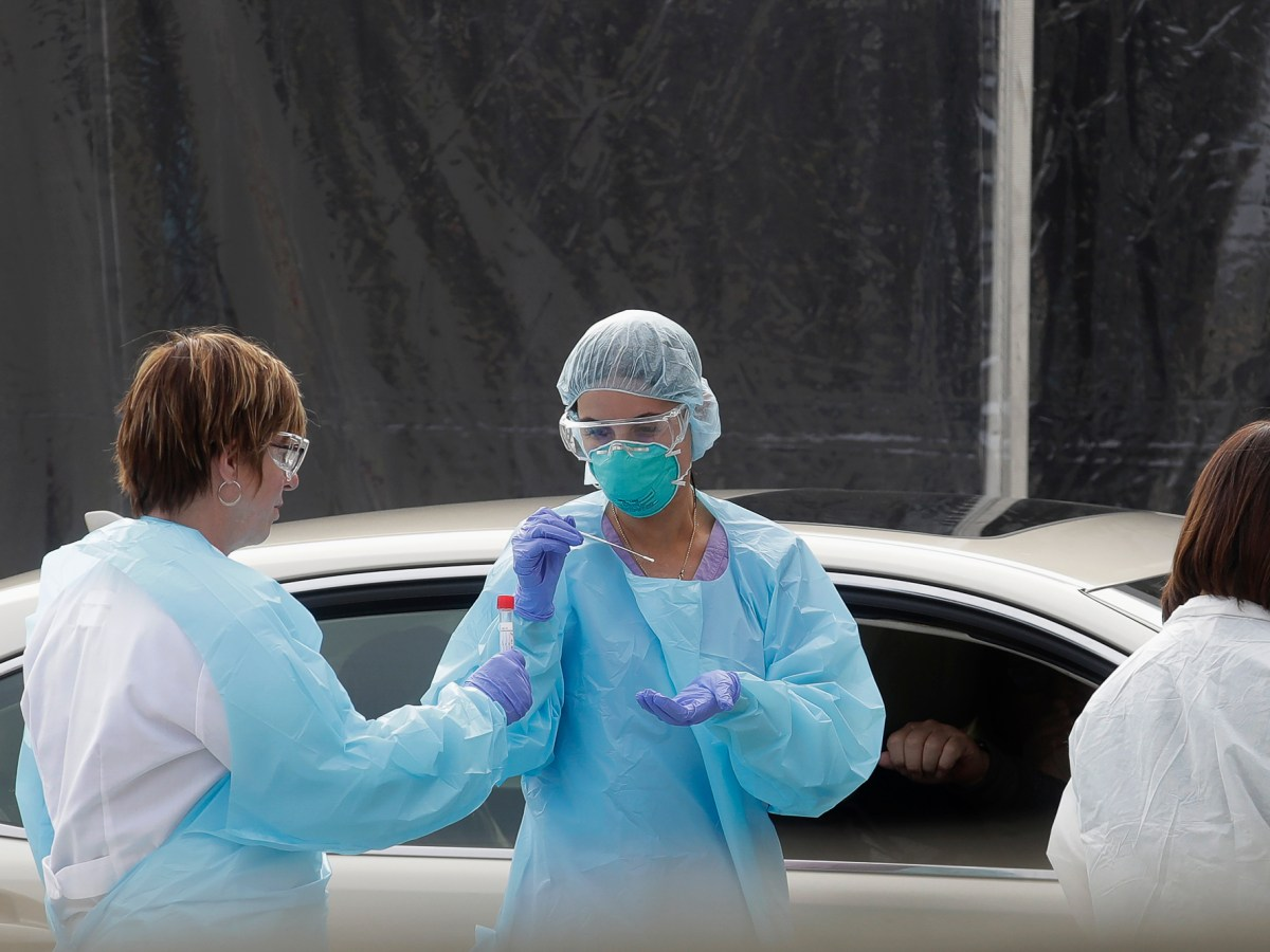 Health care personnel test a person in the passenger seat of a car for coronavirus at a Kaiser Permanente medical center parking lot in San Francisco, Thursday, March 12, 2020. Photo by Jeff Chiu, AP Photo