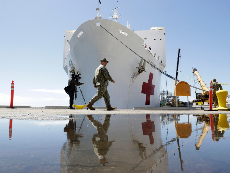 The USNS Mercy hospital ship is at dock before its departure Monday, March 23, 2020, in San Diego.