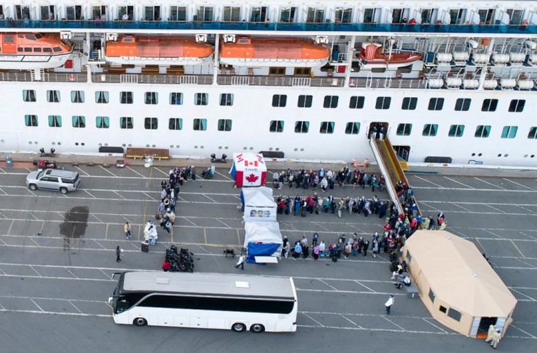 Passengers disembark from the Grand Princess cruise ship while docked at the Port of OaklandÕs Outer Harbor in Oakland, Calif., on Monday, March 9, 2020.