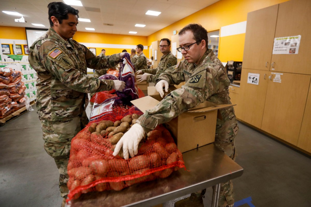 Members of the National Guard help assemble food packages at Second Harvest Food Bank in San Jose, Calif., on Tuesday, March 24, 2020. Photo by Randy Vazquez, Bay Area News Group