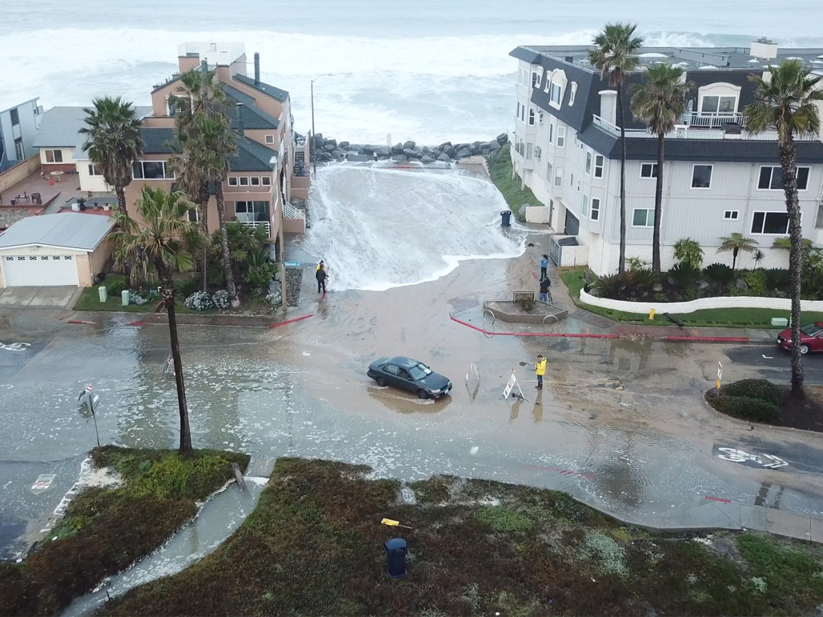 The aftermath of an ocean surge in Imperial Beach, California, January 2019. Rising seas boost tides and imperil the city's coastline. Photo via Scripps Institution of Oceanography, UC San Diego
