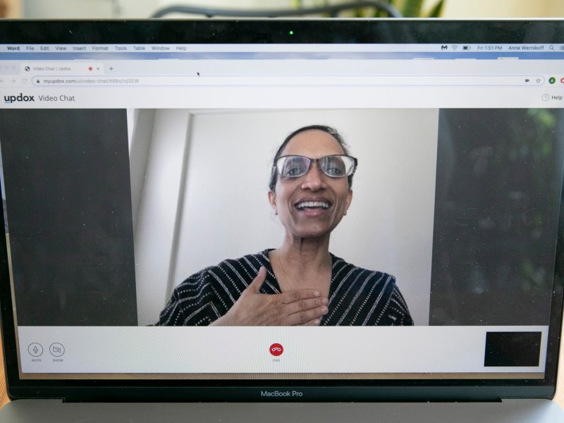 Dr. Sumana Reddy demonstrates a Telehealth exam using Updox, a HIPPA-compliant video chat software, one of several programs her clinic relies on to meet with patients.