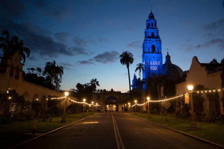 "A ""Thank You"" message and blue floodlights in honor of health care workers and first responders battling the new coronavirus are visible on the California Tower and Museum of Man in an empty Balboa Park, Monday, April 13, 2020, in San Diego. Photo by Gregory Bull, AP Photo"
