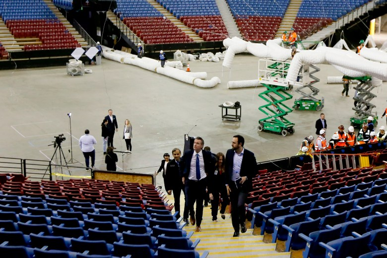 Gov. Gavin Newsom tours the Sleep Train Arena, former home of the Sacramento Kings basketball team in Sacramento on Monday, April 6, 2020. The arena is being transformed into a 400-bed emergency field hospital to help deal with the coronavirus. Photo by Rich Pedroncelli, AP Photo/Pool