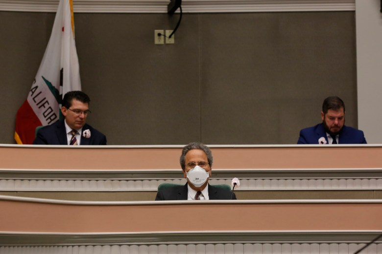 Assemblymember Richard Bloom, center, and members of the Assembly budget committee, practice social distancing during an oversight hearing of the Assembly budget special subcommittee on COVID-19 at the Capitol on April 20, 2020.