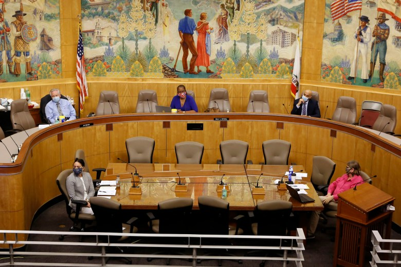 Following social distancing guidelines, members and staff of the Senate budget committee stay six feet apart, during a hearing of the special subcommittee on COVID-19 on April 16, 2020. Lawmakers are looking into how Gov. Gavin Newsom has been spending money to address the new coronavirus crisis. Due to the unusual circumstances only Sen. Jim Nielsen, R-Gerber, left, vice chair of the committee and Sen. Holly Mitchell, D-Los Angeles, center, chair of the budget committee, attended the hearing in person while other committee members joined by video. Photo by Rich Pedroncelli, AP Photo/Pool