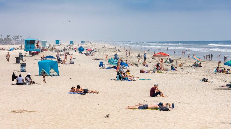 Beach goers enjoy the sun and sand near the Huntington Beach Pier in Huntington Beach on April 30, 2020. Photo by Leonard Ortiz, Orange County Register/SCNG