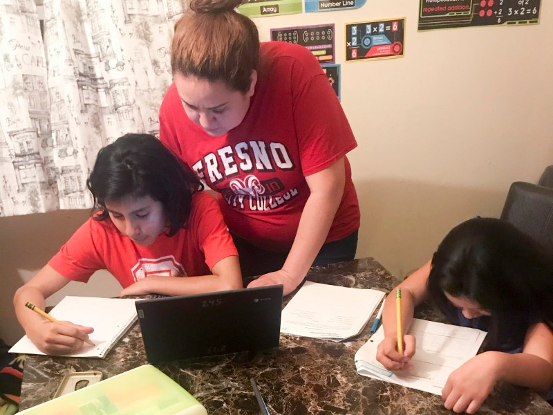 Amanda Reyes helps her kids Claudio, 13, and Evangelyn, 9, with their school work. Photo courtesy of Amanda Reyes