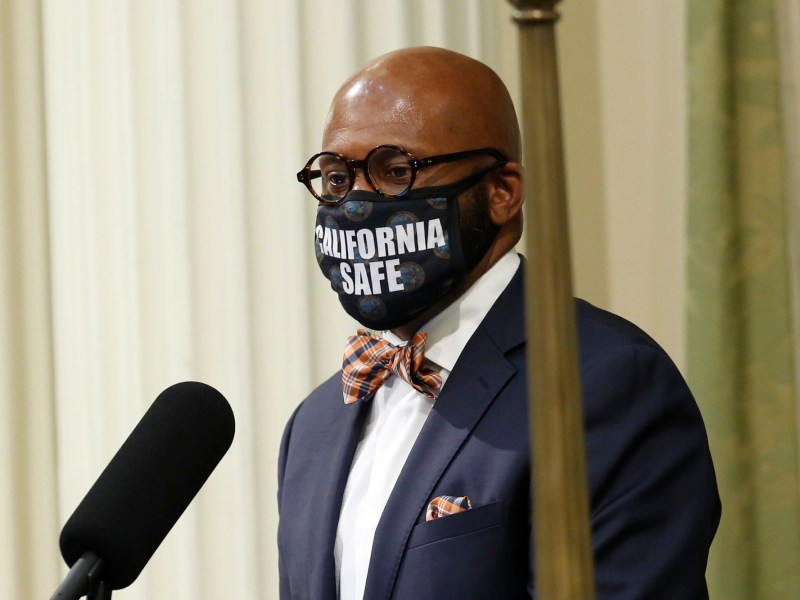 Assemblymember Mike Gipson wears a face mask with the words California Safe, as he addresses the Assembly during a committee of the whole, a parliamentary process held for the first time in 25 years to question Gov. Gavin Newsom's administration's plan to fill an estimated $54.3 budget deficit created by the effects of the coronavirus. Photo by Rich Pedroncelli, AP Photo/Pool