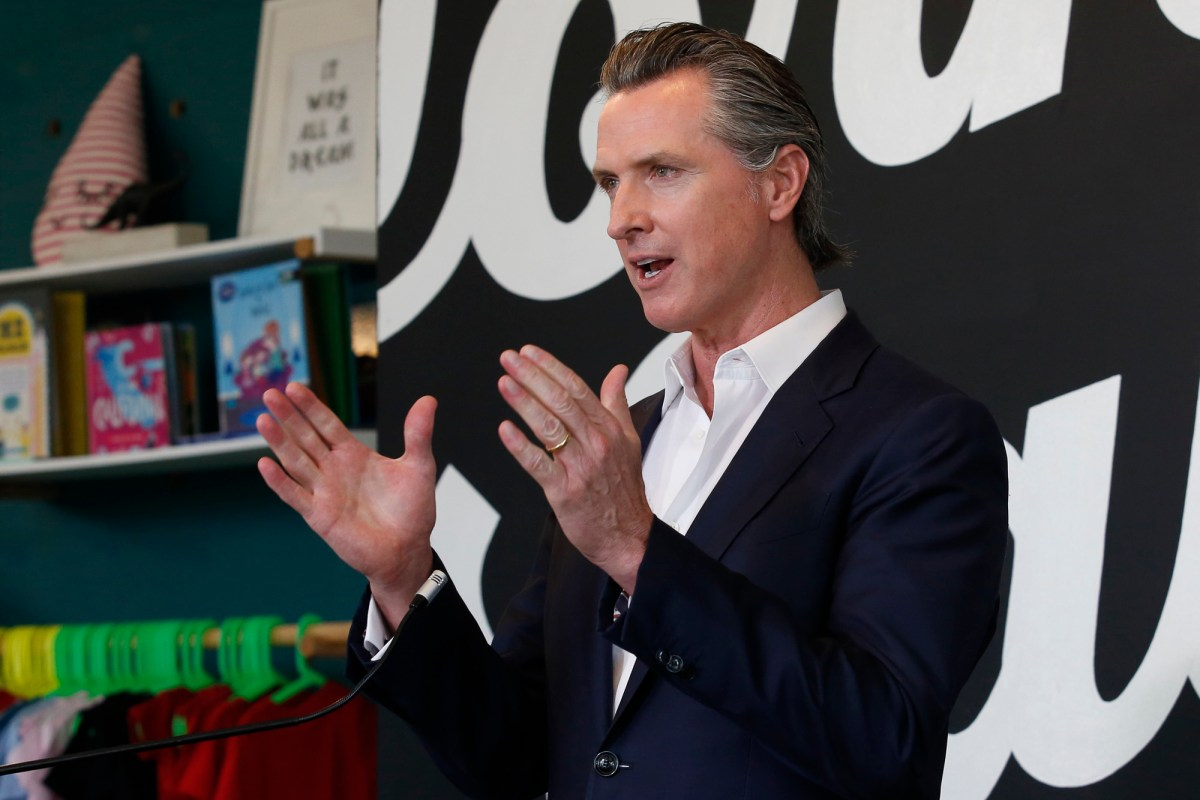 Gov. Gavin Newsom discusses his plan for the gradual reopening of California businesses during a news conference at the Display California store in Sacramento May 5, 2020.