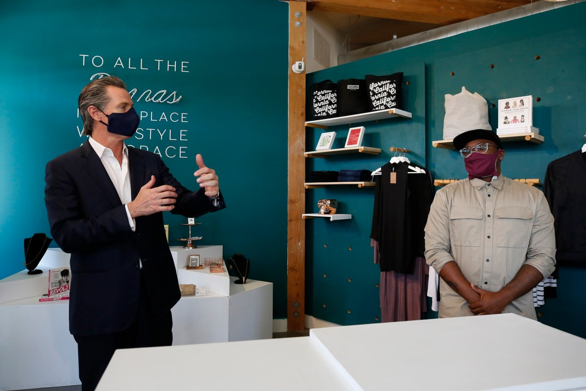 Gov. Gavin Newsom, left, talks with Roshaun Davis, owner of Display California, about the locally made items he sells at his store in Sacramento on May 5, 2020. Newsom visited the store and discussed his plan for the gradual reopening of California businesses. Photo by Rich Pedroncelli, AP Photo/Pool