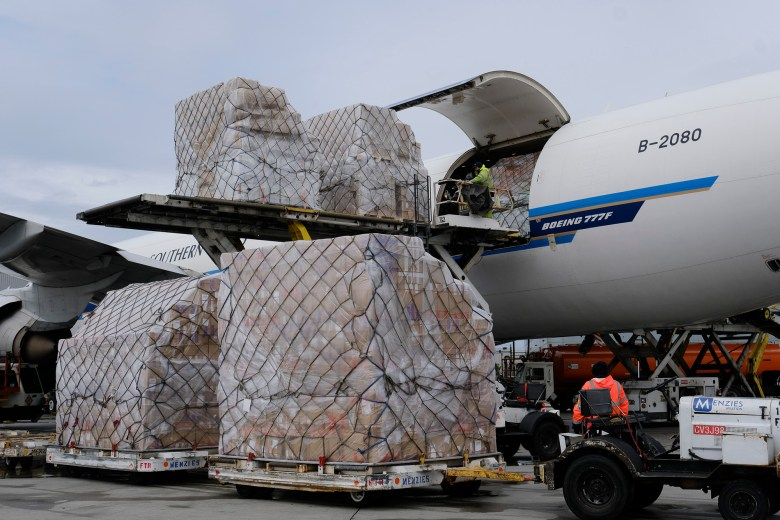 Ground crew at the Los Angeles International airport unload pallets of medical personal protective equipment from a China Southern Cargo plane upon its arrival on April 10, 2020. Photo by Richard Vogel, AP Photo