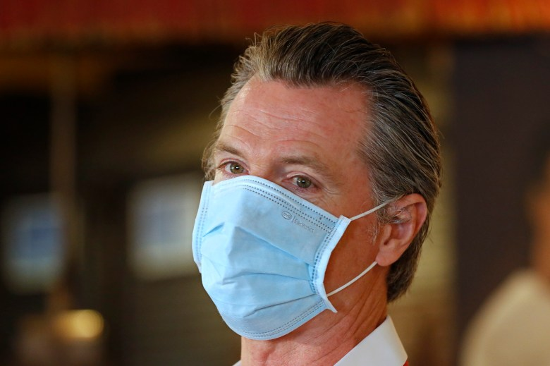 Gov. Gavin Newsom, wears a face mask as he answers a reporters question during his visit to the Queen Sheba Ethiopian Cuisine restaurant in Sacramento on Friday, June 19, 2020. Newsom visited the restaurant that is participating in the Great Plates Delivered program that provides meals to older adults who are at-risk to COVID-19. Photo by Rich Pedroncelli, AP Photo/Pool
