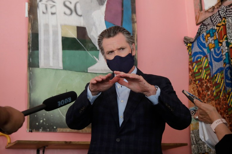 Gov. Gavin Newsom wears a protective mask on his face while speaking to reporters at Miss Ollie's restaurant during the coronavirus outbreak in Oakland, Calif., Tuesday, June 9, 2020. Photo by Jeff Chiu, AP Photo/Pool
