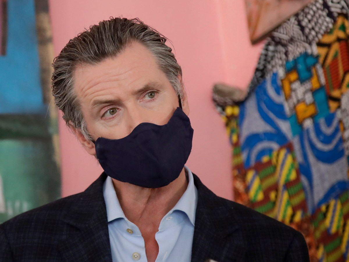 Gov. Gavin Newsom wears a protective mask on his face while speaking to reporters at Miss Ollie's restaurant during the coronavirus outbreak in Oakland on Tuesday, June 9, 2020. Photo by Jeff Chiu, AP Photo/Pool