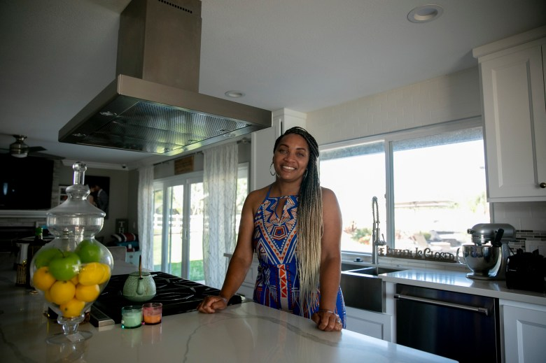 Sharie Wilson in the kitchen of her remodeled Elk Grove home on June 22, 2020. Wilson says that when the bought the home it was the 'worst on the block' but was able to turn it into a space that she's proud of. Photo by Anne Wernikoff for CalMatters