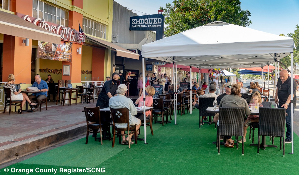 Guests dine on Glassell Street outside of Citrus City Grill and Smoqued California Barbecue in Orange on July 8, 2020 after the city closed off sections of Glassell Street to allow restaurants in Old Towne Orange to offer outdoor dining on the sidewalk and streets to comply with the state's COVID-19 guidelines. Photo by Leonard Ortiz, Orange County Register/SCNG