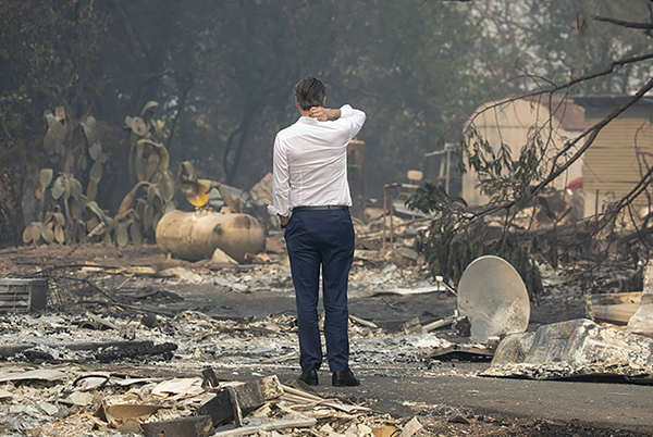 Gov. Gavin Newsom surveys a home destroyed in the Kincade Fire, Oct. 25, 2019, in Geyserville. Photo by Karl Mondon, Bay Area News Group