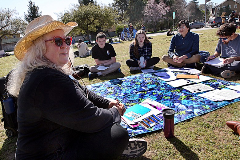 Lecturer Roxi Power teaches her Writing 1 class on the grass near the campus main entrance during a graduate student strike at UC Santa Cruz on February 18, 2020. Photo by Dan Coyro, Santa Cruz Sentinel
