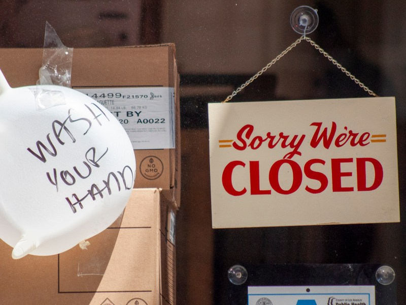 Window with a closed sign due to the closure of almost all businesses amid the Coronavirus outbreak, Downtown Los Angeles, April 11 2020. Photo by Ana M Amortegui via iStock