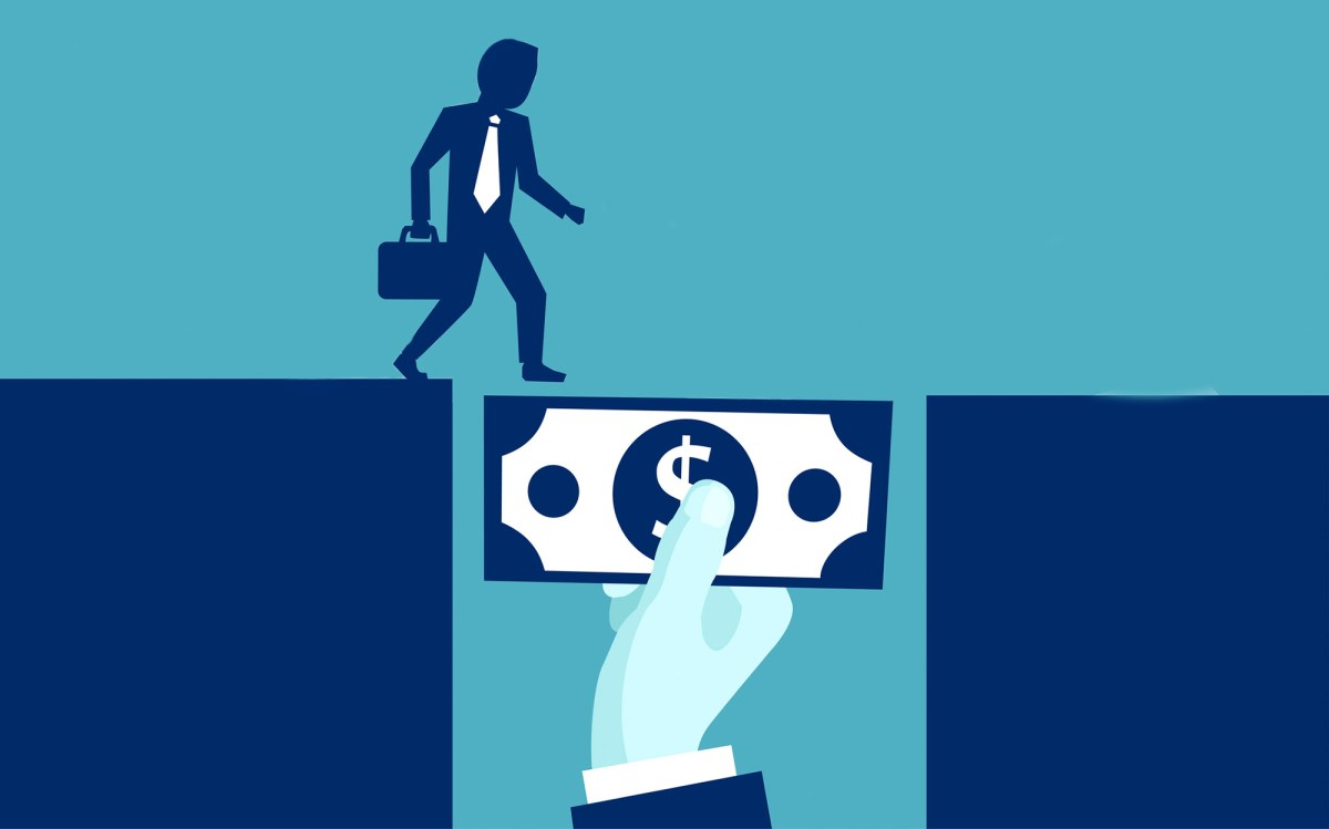 A businessman crosses a chasm, using a dollar bill as a bridge. Chasing greater returns, CalPERS prepares to enter the banking business and take on private debt. is Image via iStock