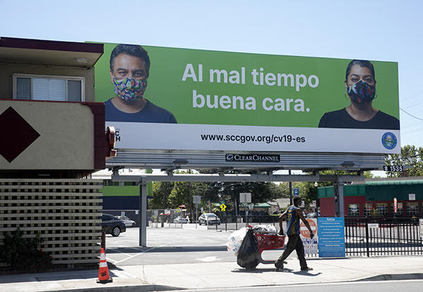 A Spanish language billboard from Santa Clara County encourages residents to wears masks with the expression 'when times are bad, put your best face forward' in San Jose on August 14, 2020. Photo by Anne Wernikoff for CalMatters
