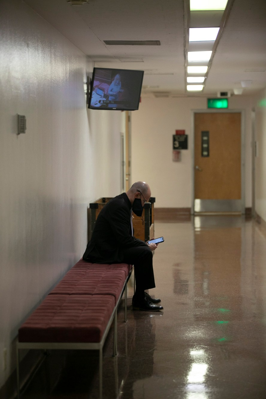 The senate hallway, normally bustling with staff and lobbyists, is quiet as the senate conduct their floor session on Aug. 31, 2020. Photo by Anne Wernikoff for CalMatters