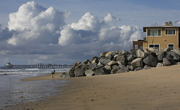 A rock barrier fronts homes at the ocean's edge in Imperial Beach, California, March 2020. Photo by Peggy Peattie for CalMatters