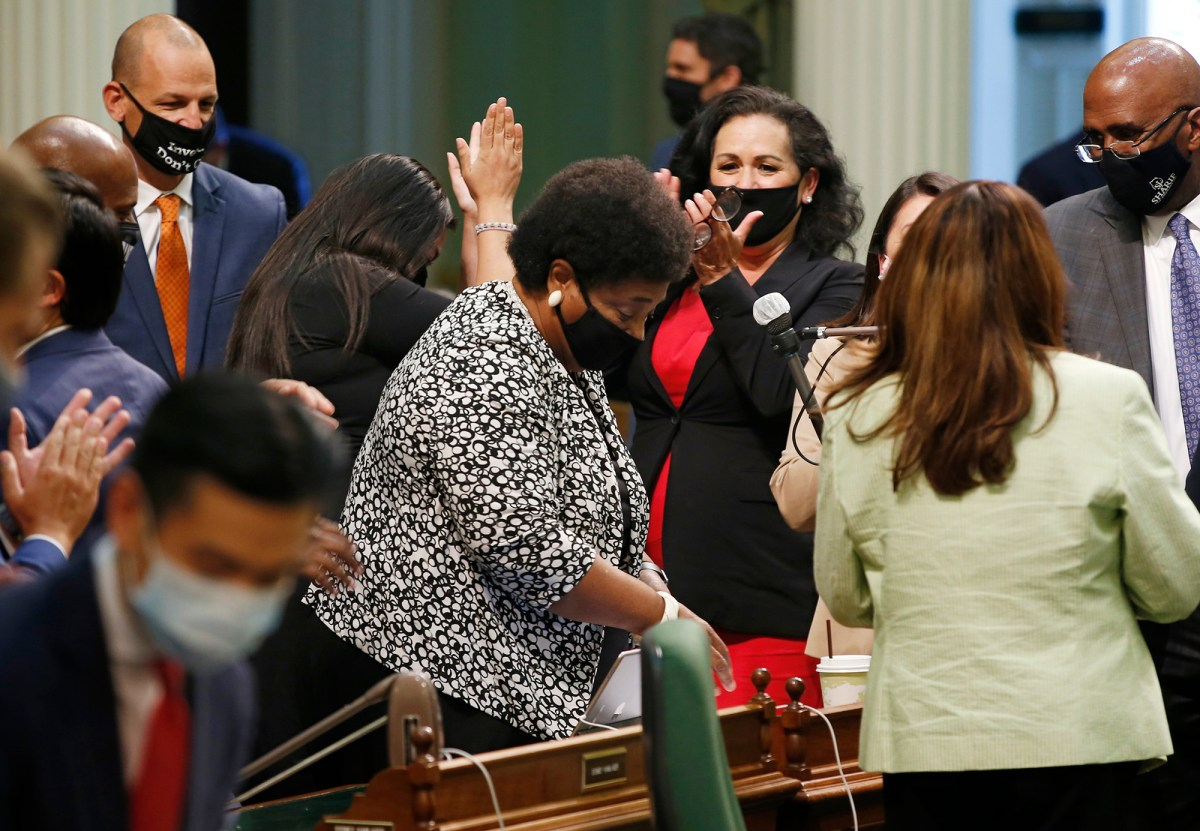 Assemblymember Shirley Weber, center, receives applause from fellow lawmakers after the Assembly approved her measure to place a constitutional amendment on the ballot to let voters decide if the state should overturn its ban on affirmative action programs, at the Capitol in Sacramento June 10, 2020. Photo by Rich Pedroncelli