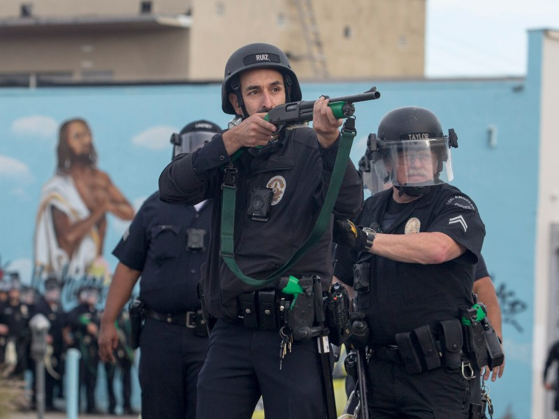 Police officers fire rubber bullets at demonstrators protesting the death of George Floyd, who was killed by Minneapolis police, in Los Angeles on May 30, 2020. Photo by Ringo H.W. Chiu, AP Photo