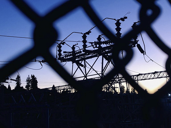 PG&E's Oakland K substation is silhouetted at sunset in the hills of Oakland on October 9, 2019. Photo by Jane Tyska, Bay Area News Group