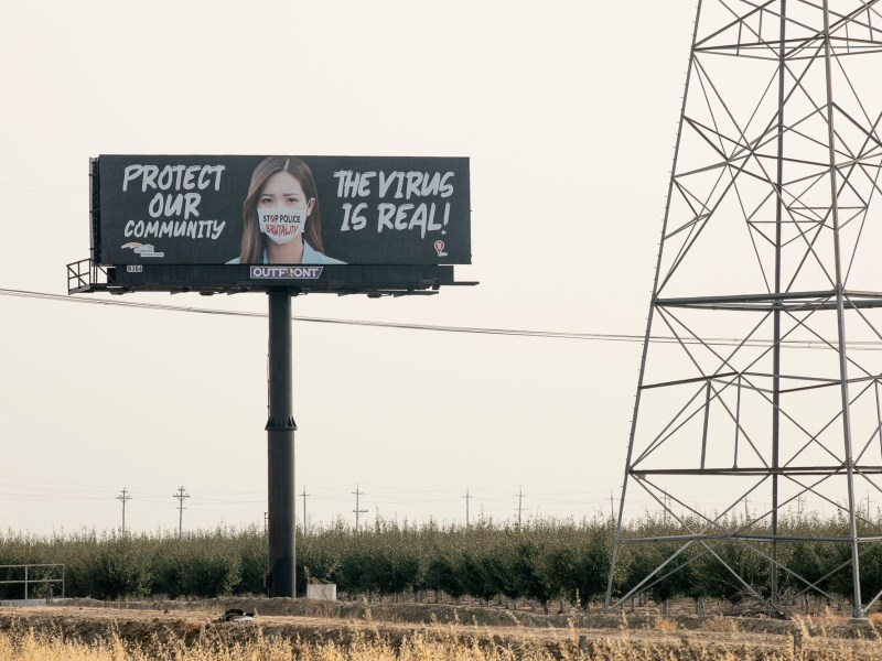 A billboard encouraging drivers to wear a mask posted along I-80 outside of Vacaville on Aug. 28, 2020. Photo by Anne Wernikoff for CalMatters