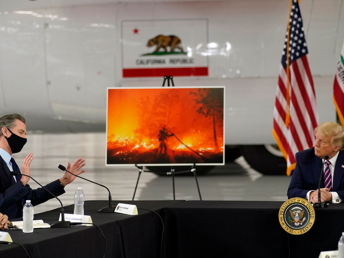 President Donald Trump listens as California Gov. Gavin Newsom speaks during a briefing at McClellan Park in Sacramento on Sept. 14, 2020, on the Western wildfires. Photo by Andrew Harnik, Associated Press