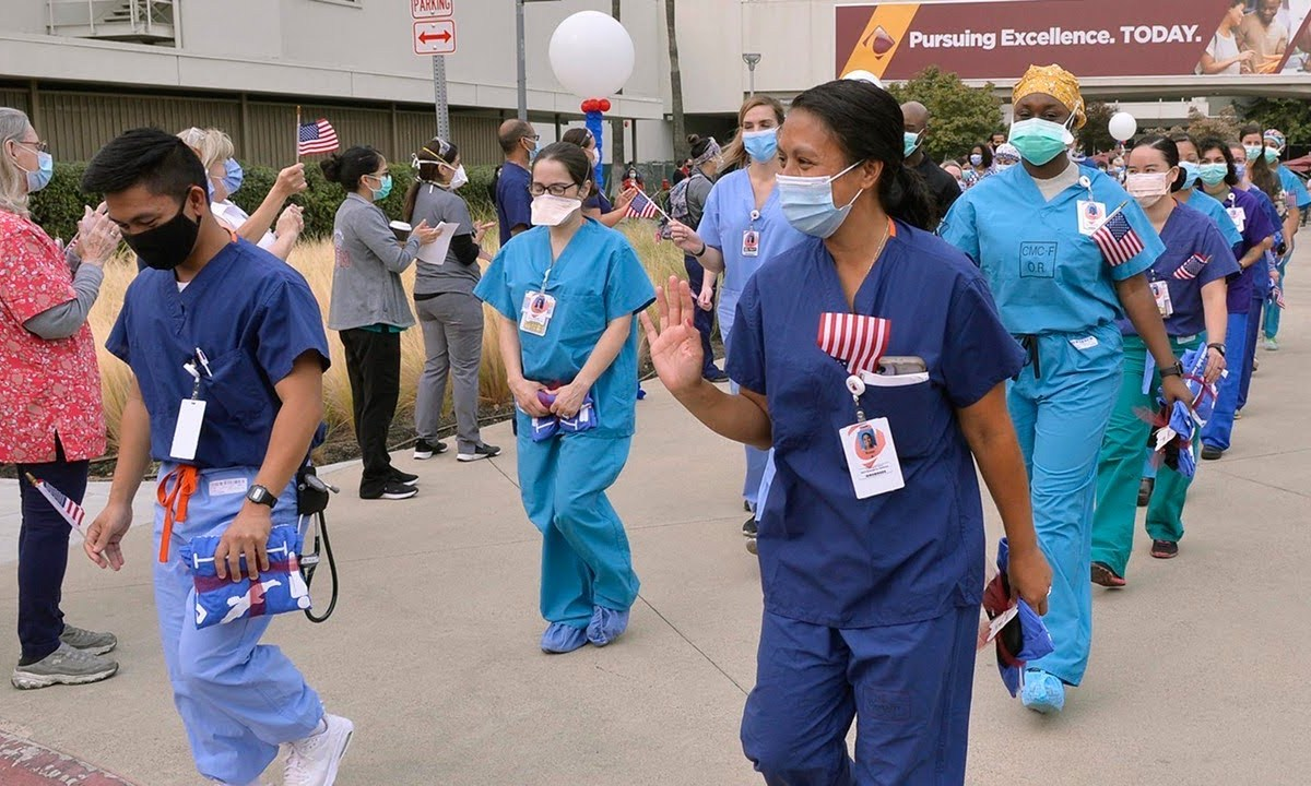 A strike team of doctors, nurses and respiratory care specialists from Travis Air Force Base was honored for their service at Community Regional Medical Center for assistance with COVID-19 cases in Fresno. Photo by Eric Zamora, The Fresno Bee