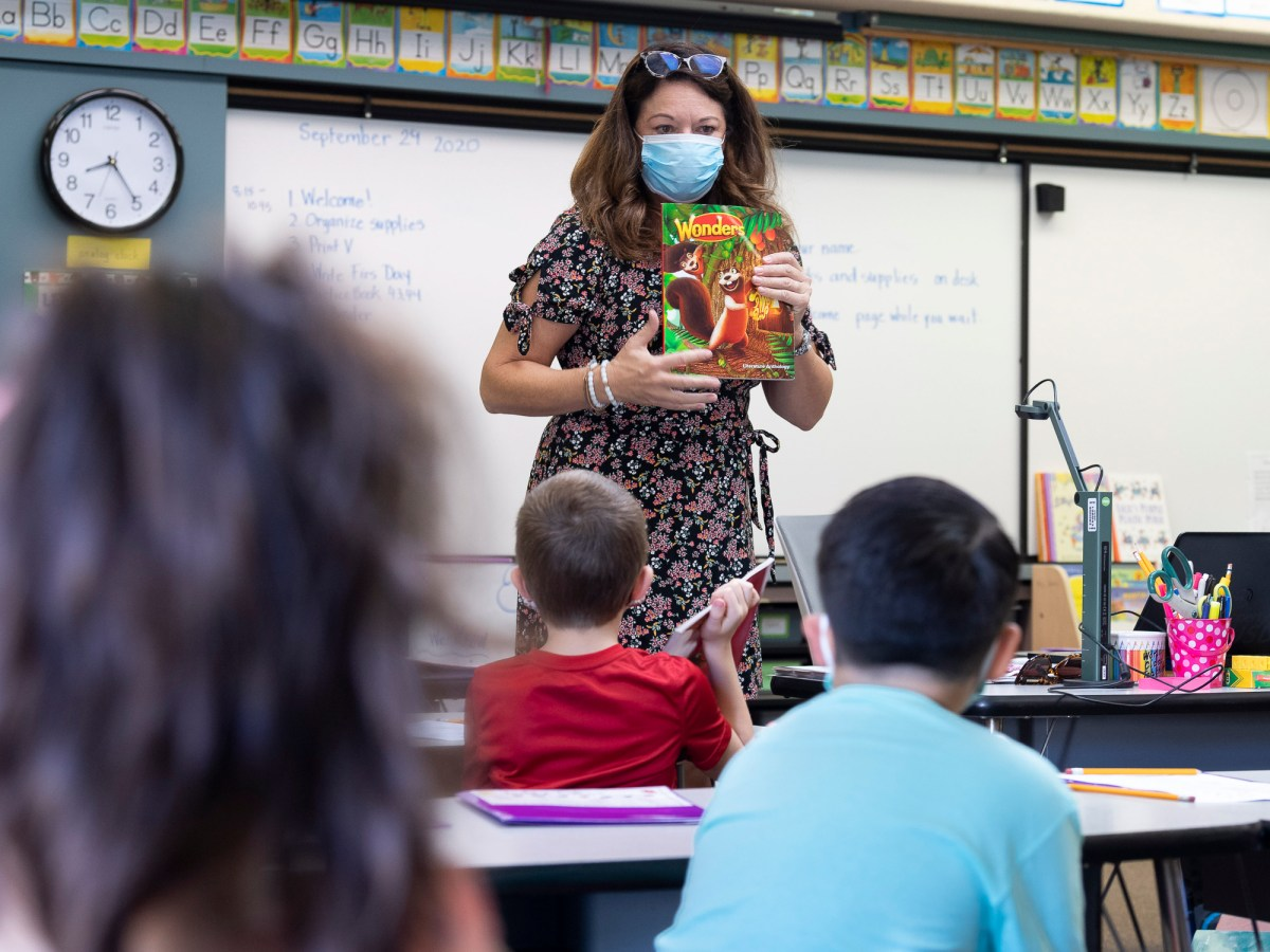 First grade teacher Mary Samis gives students instructions on the first day of in-person classes at Arroyo Vista Elementary School in Rancho Santa Margarita on September 29, 2020. Arroyo Vista is offering both full day in-person classes and half-day hybrid instruction. Photo by Paul Bersebach, Orange County Register/SCNG